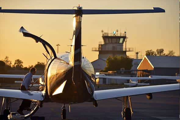 Business man flying private in a Pilatus PC-12 at sunset