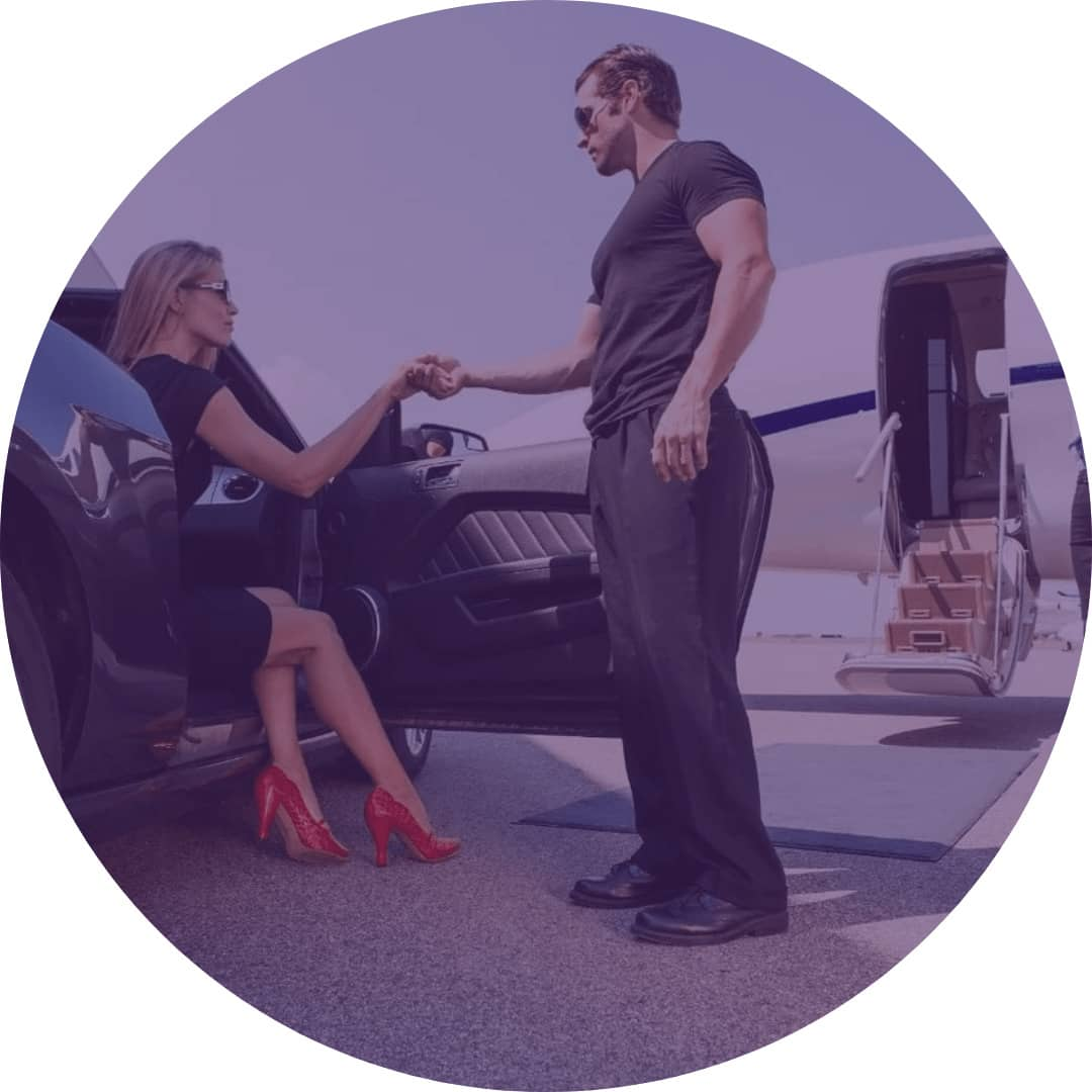 Person Helping Woman out of a car to lead them to the aircraft staircase shown in the background | Pilatus PC-12 | Plane - LIVT